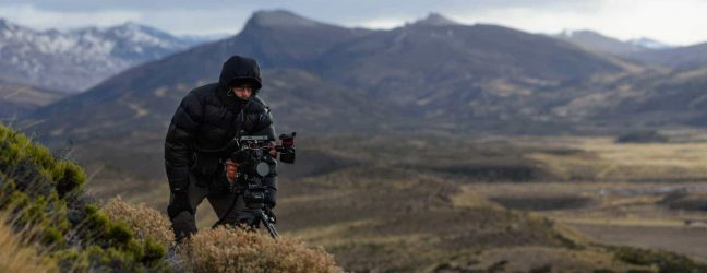 Cinematographer Theo Ribeiro during a very cold Patagonian day shooting B-roll during the making of Land of The Wind