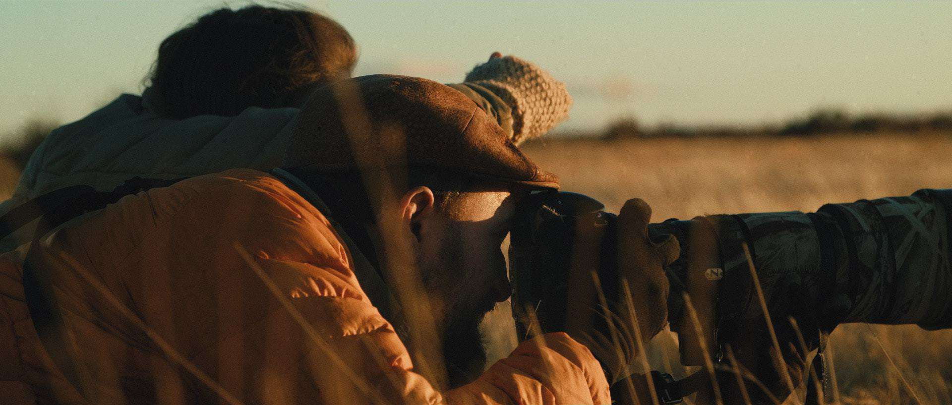 "Fine-art photographer Eliseo Miciu and Violeta Folguera chase the elusive Patagonian wild horses - Still frame from the documentary ""Land of The Wind"""