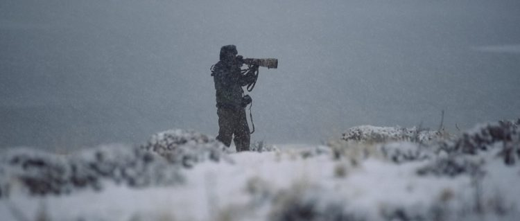 "Fine-art photographer Eliseo Miciu fights the snow photographing in the harsh Patagonian winter - Still frame from the documentary ""Land of The Wind"""